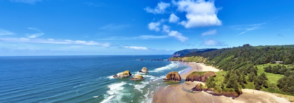 Aerial wide panorama shot at approximately 350 feet above Cannon Beach looking towards Ecola State Park on the Oregon Coast-1-2