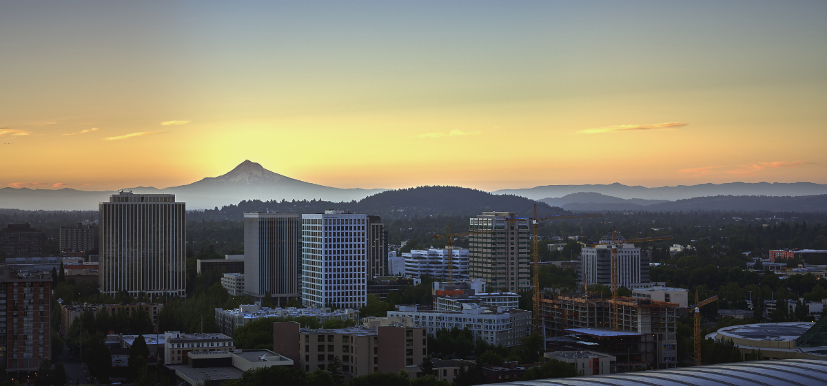 Drone aerial panorama at sunrise looking over the top of the MODA Center with Mt Hood in the background
